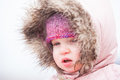 A toddler braves the cold and snow is wrapped up warm in wintery conditions at lake mountain in victoria australia Stock Photography