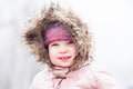 A toddler braves the cold and snow is wrapped up warm in wintery conditions at lake mountain in victoria australia Royalty Free Stock Images