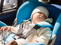 Toddler in a car seat Stock Photos