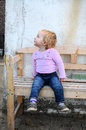 Toddler cute little girl sitting on a bench Royalty Free Stock Photo