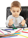 Toddler drawing little boy playing with colorful pencils trying to draw Stock Images