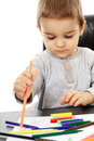 Toddler drawing little boy playing with colorful pencils trying to draw Stock Image