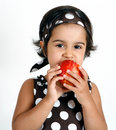 Toddler eating apple Royalty Free Stock Photography