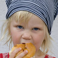 Toddler eating bread roll Royalty Free Stock Photography