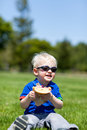 Toddler eating sandwich Stock Image