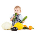 Toddler eating squash Royalty Free Stock Photography