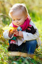 Toddler girl in autumn park Royalty Free Stock Photo
