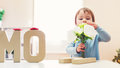 Toddler girl celebrating Mothers Day Royalty Free Stock Photo