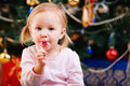 Toddler girl with Christmas candy Stock Photography