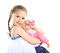 Toddler girl with doll on a white background Royalty Free Stock Images