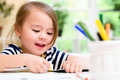 Toddler girl drawing and doing crafts Royalty Free Stock Photo