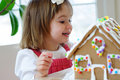 Toddler girl with gingerbread cookie Stock Photography