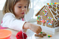 Toddler girl with gingerbread cookie Stock Photos