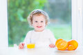 Toddler girl having orange juice for breakfast Royalty Free Stock Photo