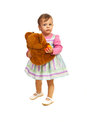 Toddler girl holding teddy bear Stock Photos