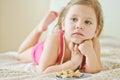 Toddler girl at home watching tv Royalty Free Stock Photos