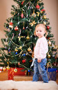 Toddler girl near Christmas tree Royalty Free Stock Image