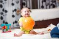 Toddler girl playing with ball indoor Royalty Free Stock Photo