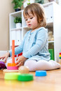 Toddler girl playing with toys Royalty Free Stock Photo