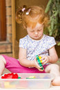 Toddler girl playing toys plastic learning Stock Photography