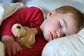 Toddler girl sleeping in bed