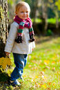 Toddler girl standing near tree Stock Photography