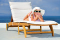 Toddler girl on sunbed relaxing Royalty Free Stock Photo