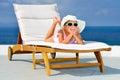 Toddler girl on sunbed relaxing Stock Image