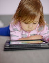 Toddler girl using tablet pc Stock Image