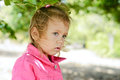 Toddler girl in windy weather Royalty Free Stock Photo