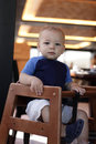 Toddler in highchair Royalty Free Stock Photos