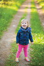 Toddler laughing girl in forest Royalty Free Stock Photo
