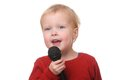Toddler with microphone Royalty Free Stock Image