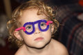 Toddler with pipe cleaner glasses looking serious Royalty Free Stock Photography