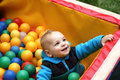 Toddler playing box balls playground Stock Photo