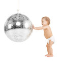 Toddler playing with disco ball Royalty Free Stock Photo