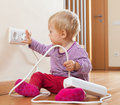 Toddler playing with electricity at home Royalty Free Stock Photography
