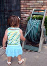 Toddler Playing with Garden Hose Stock Photos