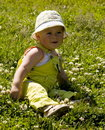Toddler playing on meadow Stock Images