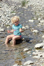 Toddler playing in river Royalty Free Stock Images