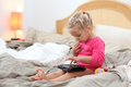 Toddler playing with a tablet pc Royalty Free Stock Image