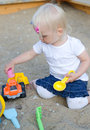 Toddler plays with toys on sandbox Royalty Free Stock Images