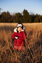 Toddler posing in a field at sunset Royalty Free Stock Photo