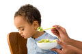 Toddler refusing to eat months old his vegetables Stock Image