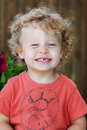 Toddler with ringlets & missing tooth Stock Images