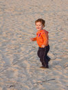 Toddler running beach Stock Image