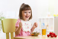 Toddler sitting at table food ready to eat in the nursery. Royalty Free Stock Photo