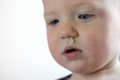 Toddler with snot hanging out of nose Royalty Free Stock Photo