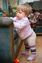 Toddler standing by chair Royalty Free Stock Image