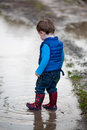 Toddler steps into a puddle Royalty Free Stock Photo